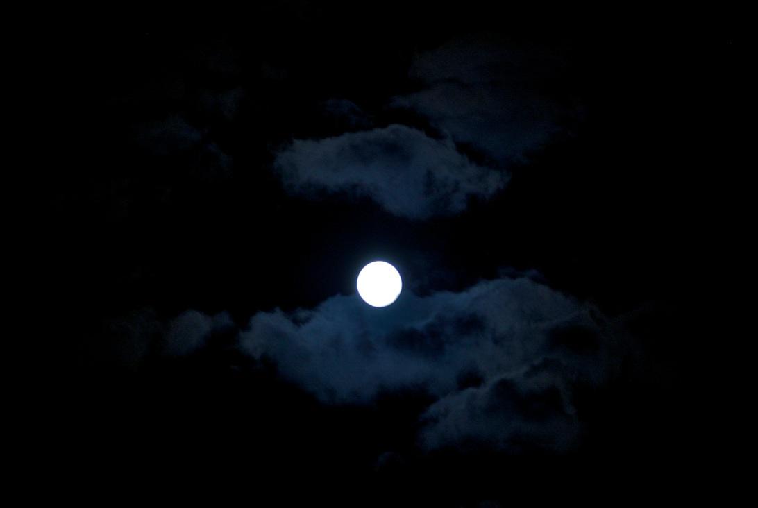 Moon backlighting clouds